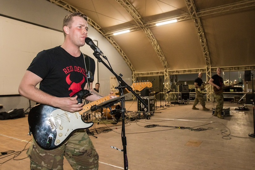 Army Sgt. Christian Bueng, a musician with the Red Devil Rock Band, 34th Red Bull Infantry Division Band, Minnesota National Guard, performs cover songs on March 16, 2019, at Camp Arifjan, Kuwait. U.S. Army Central hosts these types of events to demonstrate its enduring commitment to Soldiers' health, welfare and morale.