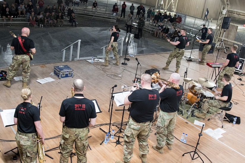 Army musicians with the Red Devil Rock Band, 34th Red Bull Infantry Division Band, Minnesota National Guard, perform cover songs on March 16, 2019, at Camp Arifjan, Kuwait. U.S. Army Central hosts these types of events to demonstrate its enduring commitment to Soldiers' health, welfare and morale.