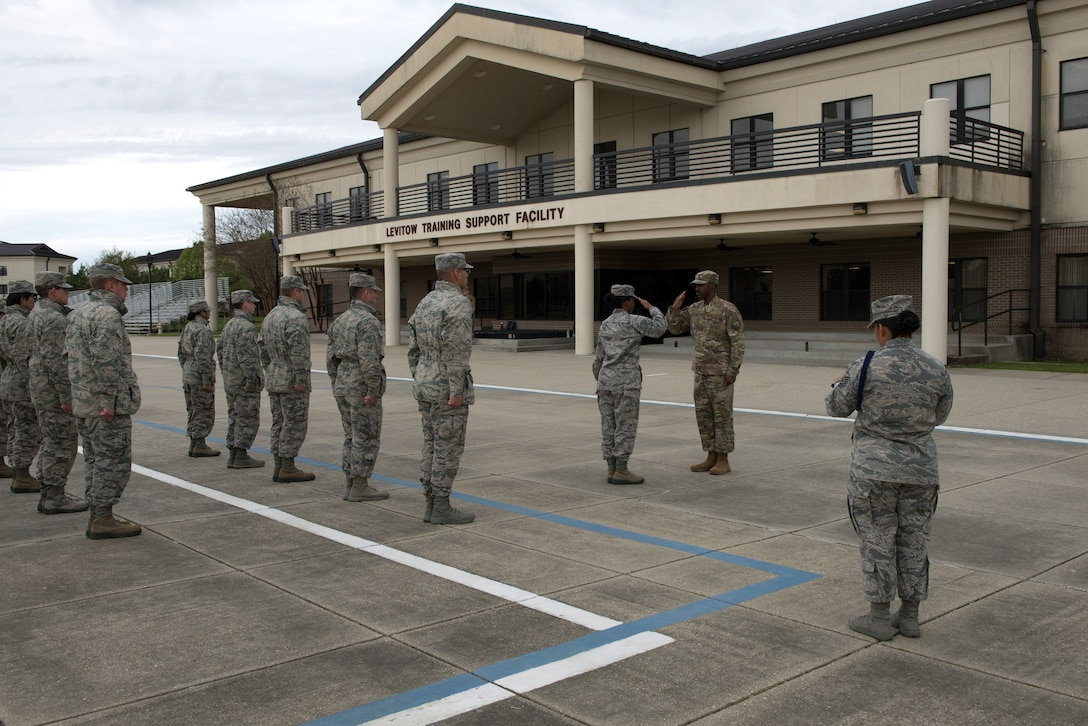 U.S. Air Force Tech. Sgt. Victoria Monzon, 81st Training Support Squadron military training leader instructor, evaluates an open-ranks inspection at the Levitow Training Support Facility drill pad at Keesler Air Force Base, Mississippi, March 15, 2019. The evaluation allowed Monzon to assist her students in performing a higher quality open-ranks inspection and strengthen the students' skill-sets as future MTLs. (U.S. Air Force photo by Airman 1st Class Kimberly Mueller)