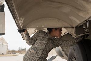 Airman conducting preflight inspection.