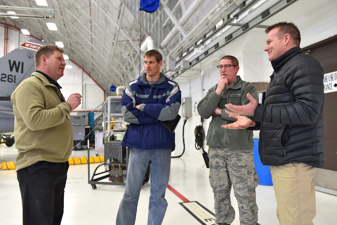 115th Fighter Wing Occupational Health Manager Thomas Egstad, left, escorts safety specialists from Midwest energy company Alliant Energy during a tour of base facilities at Truax Field in Madison, Wisconsin, Mar. 7, 2019.