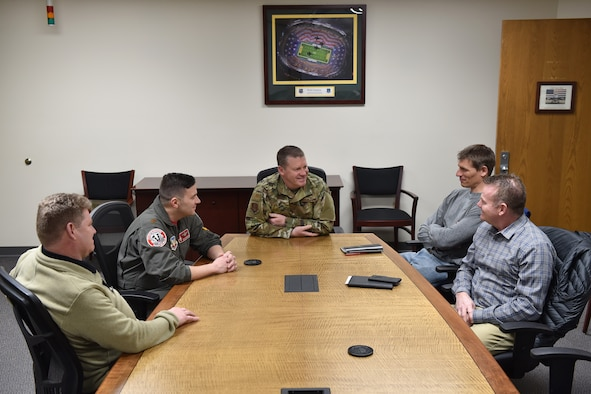 115th Fighter Wing Vice Commander Col. Christopher Green, center, joins members of the wing's safety team during a meeting with safety specialists from Midwest energy company Alliant Energy at Truax Field, Wisconsin, Mar. 7, 2019.