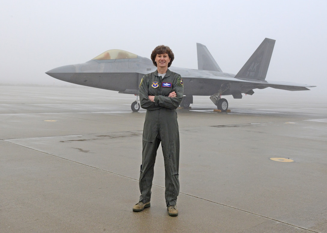 Maj. Gen. Dawn Dunlop, Special Access Program Central Office director, Office of the Undersecretary of Defense for Acquisition and Sustainment, poses for a photo in front of an F-22 Raptor at Edwards Air Force Base, California Feb. 20, 2019. Dunlop was accompanied by more than 80 fellow female aviators to take part in filming of an Air Force Recruiting Service television commercial. (U.S. Air Force photo by Kenji Thuloweit).