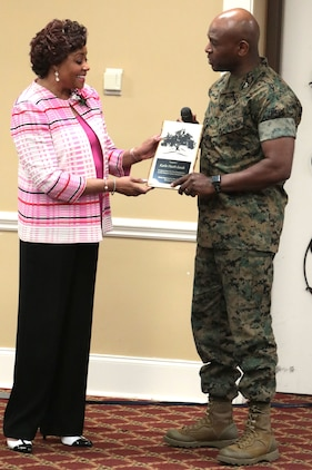 March marks Women's History Month and dozens of active-duty service members and civilian-Marines celebrated the observance with an annual program at the Town and Country Grand Ballroom aboard Marine Corps Logistics Base Albany, March 19. (U.S. Marine Corp photo by Re-Essa Buckels)