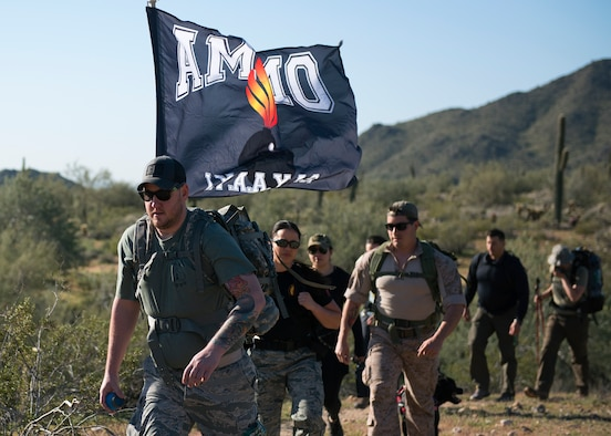 Participants in the March of the Fallen ruck march climb a hill in Buckeye, Ariz., March 16, 2019.