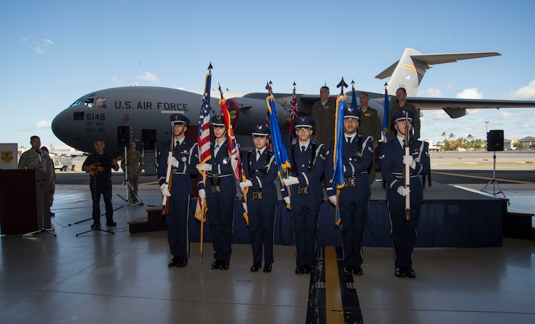 The Hickam Honor Guard presents the colors during the North Korea Aircraft Commemorative Plaque Ceremony on Joint Base Pearl Harbor-Hickam, Hawaii, March 12, 2019. The ceremony recognized two C-17 Globemaster IIIs, tail numbers 05-5147 and 05-5148, and their crewmembers who participated in bringing home 55 service members killed in the Korean War. (U.S. Air Force photo by Tech. Sgt. Heather Redman)