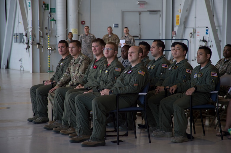 Aircrew members listen to Gen. Michael A. Minihan, U.S. Indo-Pacific Command chief of staff, during the North Korea Aircraft Commemorative Plaque Ceremony on Joint Base Pearl Harbor-Hickam, Hawaii, March 12, 2019. During the ceremony, aircrew members were recognized for their roles in the 2018 Honorable Carry mission that returned the remains of 55 American soldiers killed in the Korean War to the U.S. (U.S. Air Force photo by Tech. Sgt. Heather Redman)