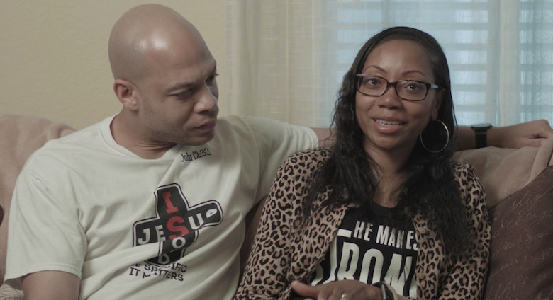Air Force Master Sgt. Antwan Piper looks at his wife, Alexis, during a video interview about her disease and her recovery at Brooke Army Medical Center. Alexis Piper has had sickle cell anemia since she was 7 years old. She nearly died in 2018 after developing a rare condition called hyperhemolysis. Hyperhemolysis syndrome is a potentially fatal transfusion complication. (U.S. Air Force photo by Corey Toye)