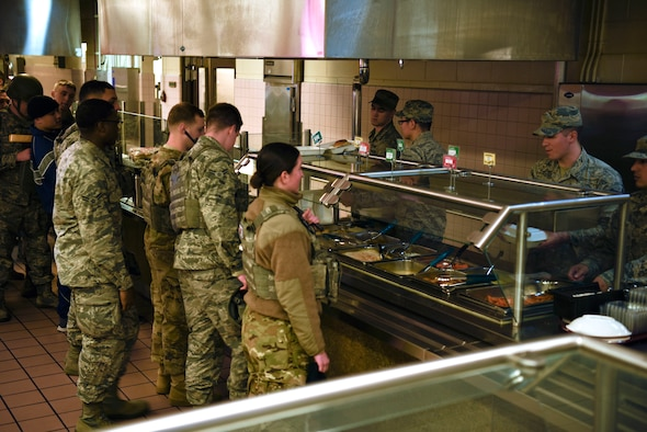 8th Force Support Squadron Airmen serve a contingency meal as part of their training to 8th Fighter Wing personnel at Kunsan Air Base, Republic of Korea, March 14, 2019. 8th FSS Airmen trained on the planning, preparing and serving of a hot meal during a contingency event. (U.S. Air Force photo by Tech. Sgt. Charles McNamara)