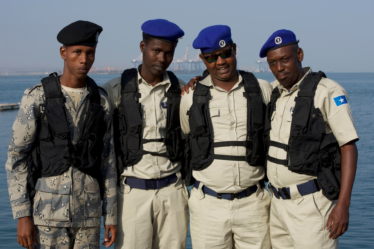Service members from Djibouti and Somalia pose for a photo.