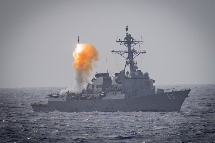 A ship launches a missile.