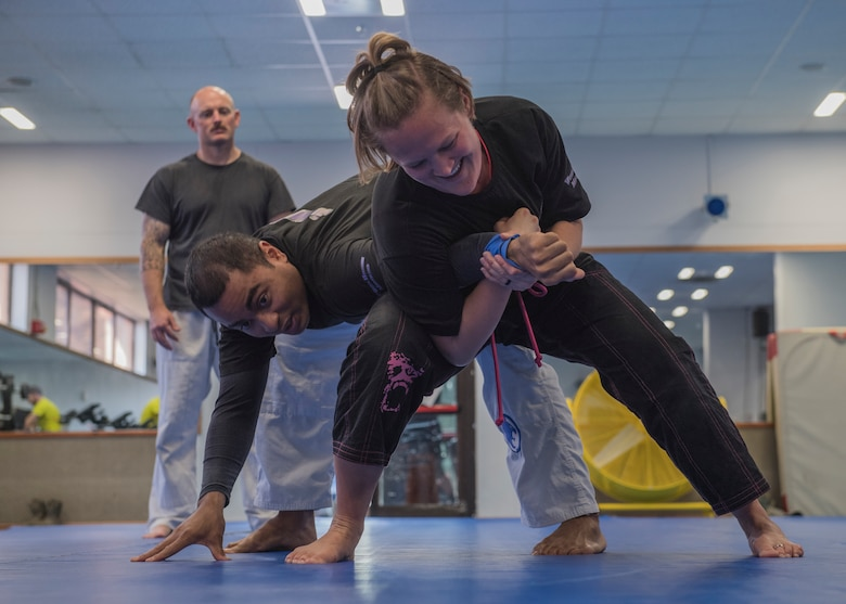 Maj. Lydia Rodriguez, 39th Medical Operations Squadron Medical Services Flight commander, demonstrates a hold on Tech. Sgt. James Baldwin, 39th Security Forces Squadron NCO in-charge of standardization and evaluations, during a self-defense class March 19, 2019, at Incirlik Air Base, Turkey.