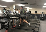Don Phillips, DLA Installation Support at Battle Creek site director, uses a treadmill in the Federal Center's Fitness Center to complete his run.