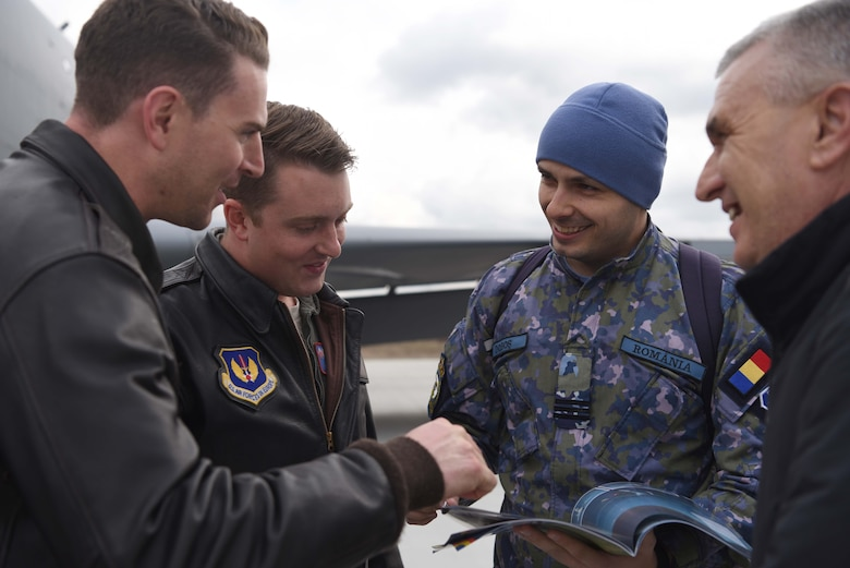 U.S. Airmen and Romanian air force members discuss aerial refueling events after training with Romanian air force F-16s in Bucharest, Romania, March 12, 2019. The crew trained with Romanian air force F-16s over the skies of Romania, which enhanced regional capabilities to secure air sovereignty and promote peace and security through cooperation, collaboration, interoperability with NATO allies in the region. (U.S. Air Force photo by Airman 1st Class Brandon Esau)