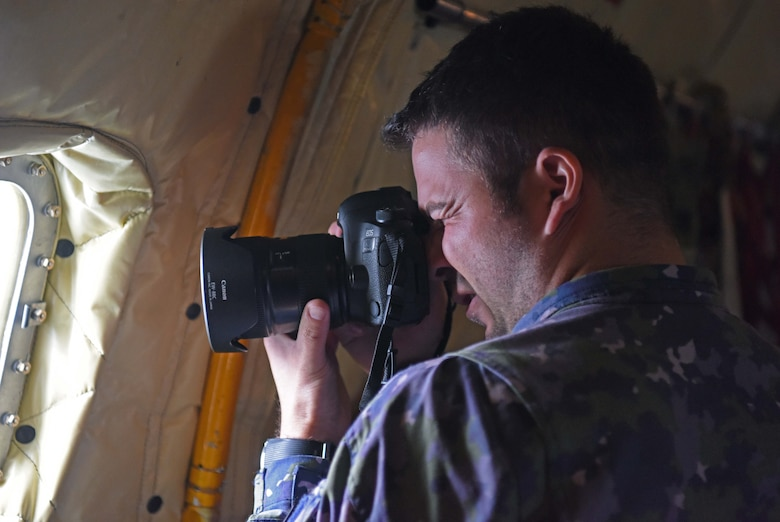 Romanian air force Warrant Officer Bogdan Pantilimon takes photos during aerial refueling training with Romanian F-16s over the skies of Romania, March 12, 2019. The training was an example of U.S. and NATO allies sharing a commitment to promote peace and stability through developing their relationship and communication process. (U.S. Air Force photo by Airman 1st Class Brandon Esau)