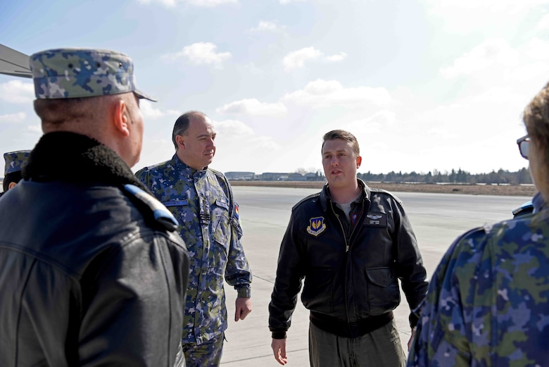 U.S. Air Force Capt. Logan Dean, 351st Air Refueling Squadron pilot, discusses aerial refueling events with Romanian air force members prior to take-off for training with Romanian air force F-16s in Bucharest, Romania, March 13, 2019. The training was an example of U.S. and NATO allies sharing a commitment to promote peace and stability through developing their relationship and communication process. (U.S. Air Force photo by Airman 1st Class Brandon Esau)