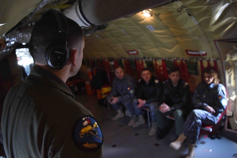 U.S. Air Force Senior Airman Corey Marion, 351st Air Refueling Squadron boom operator, goes over flight procedures with Romanian air force members aboard a KC-135 Stratotanker in Bucharest, Romania, March 13, 2019. The crew trained with Romanian air force F-16s over the skies of Romania, which enhanced regional capabilities to secure air sovereignty and promote peace and security through cooperation, collaboration, interoperability with NATO allies in the region. (U.S. Air Force photo by Airman 1st Class Brandon Esau)