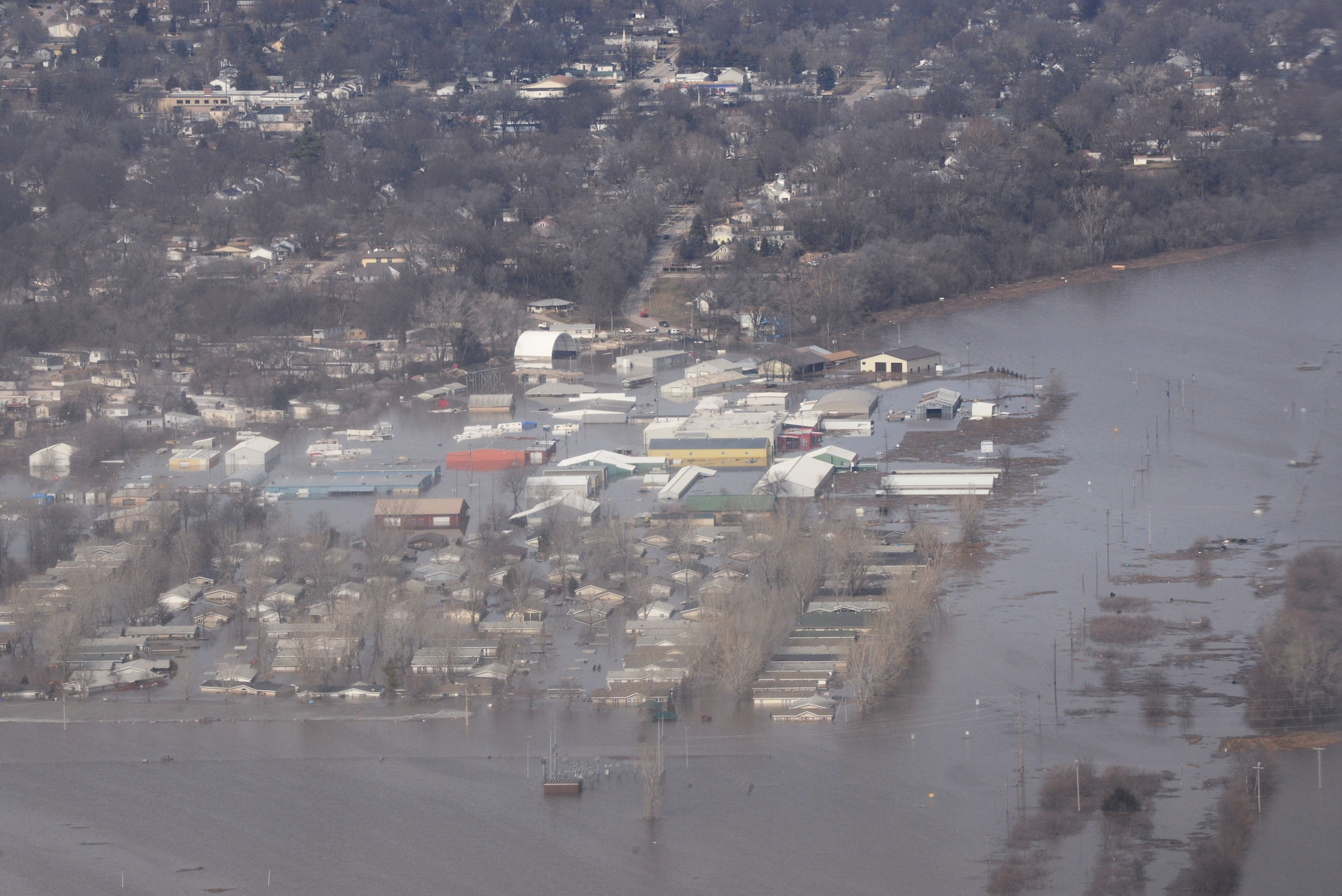 Areas surrounding Offutt Air Force Base stand affected by flood waters March 17, 2019. An increase in water levels of surrounding rivers and waterways caused by record-setting snowfall over the winter in addition to a large drop in air pressure caused widespread flooding across the state of Nebraska. (U.S. Air Force photo by TSgt. Rachelle Blake)