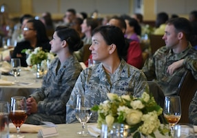 U.S. Air Force Col. Debra Lovette, 81st Training Wing commander, watches a video highlighting women in the military during the Women's History Month Luncheon at the Bay Breeze Event Center on Keesler Air Force Base, Mississippi, March 19, 2019. Every March women are recognized for their contributions and impact to the military and society. According to the Air Force's Personnel center, women make up 20.3 percent of the active duty Air Force. (U.S. Air Force photo by Kemberly Groue)