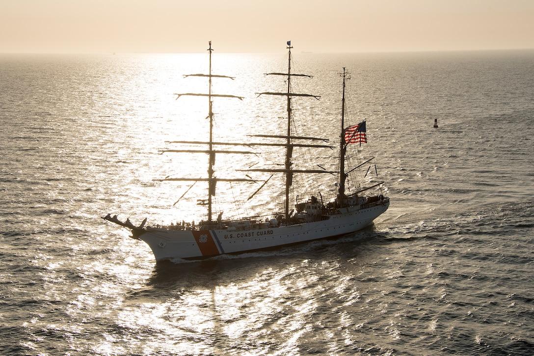 A ship transits a river.