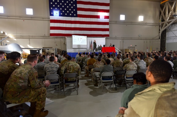 Col. Julian Cheater, 432nd Wing/432nd Air Expeditionary Wing commander, explains plans for future installation development during an all-call at Creech Air Force Base, Nevada, Mar. 8, 2019. This all-call provided 432nd WG leadership with the ability to update Airmen at Creech, as well as the geographically separated units at Ellsworth, Shaw and Whiteman AFBs. (U.S. Air Force photo by Tech. Sgt. Dillon White)