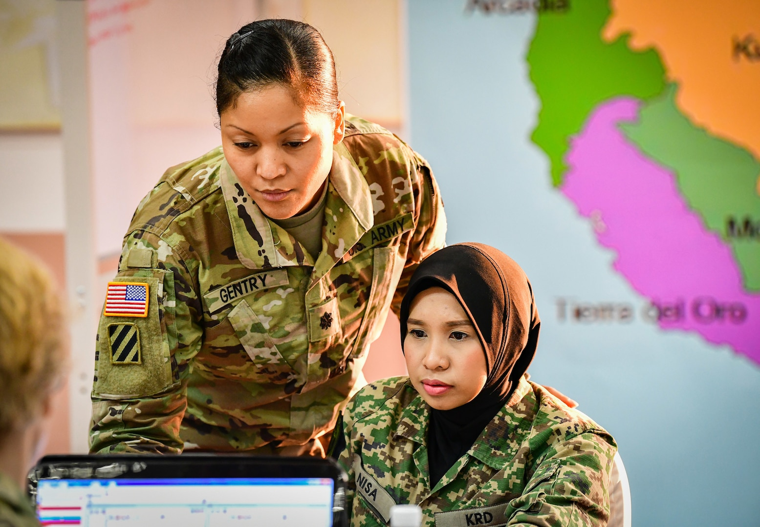 U.S. Army Lt. Col. Angela Gentry, Washington Army National Guard, discusses battle drills with her Malaysian army counterpart, Maj. Nurkhairunisa, during Exercise Bersama Warrior in Malaysia, March 10, 2019.