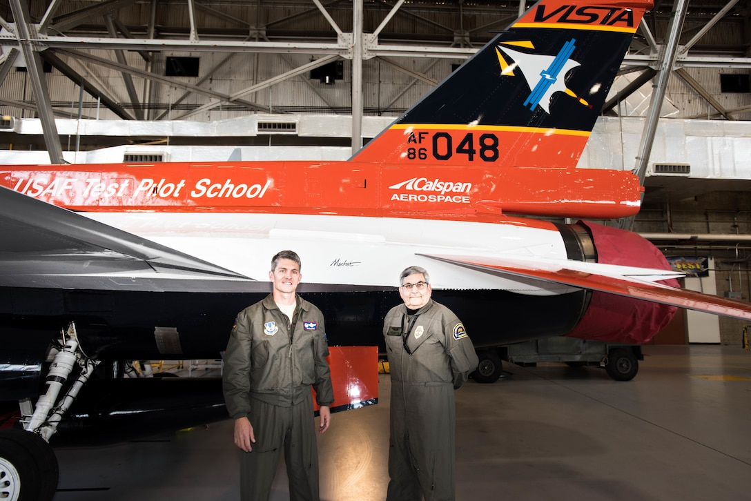 Col. Ryan Blake, U.S. Air Force Test Pilot School commandant (left), poses for a photo with aviation artist Mike Machat in front of the school's NF-16D VISTA in-flight simulator March 7. The VISTA is sporting a new paint scheme designed by Machat.   (U.S. Air Force photo by Joe Jones)
