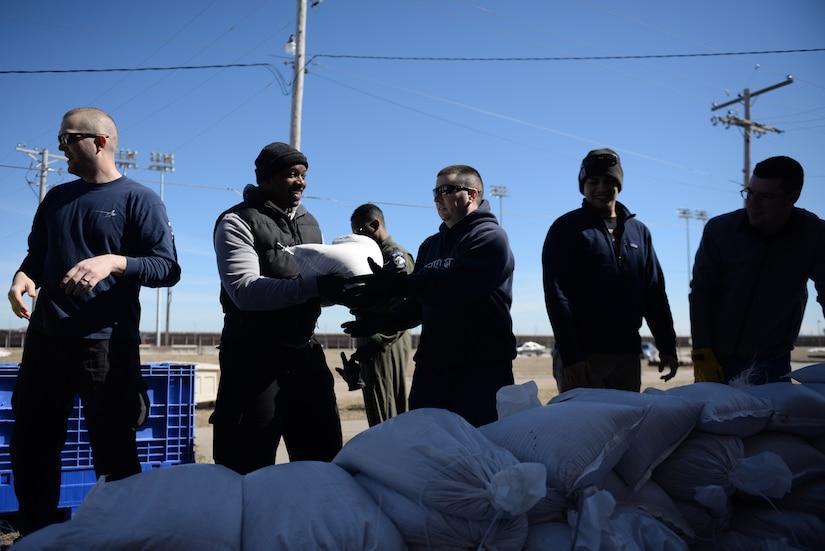 Airmen fill sandbags.