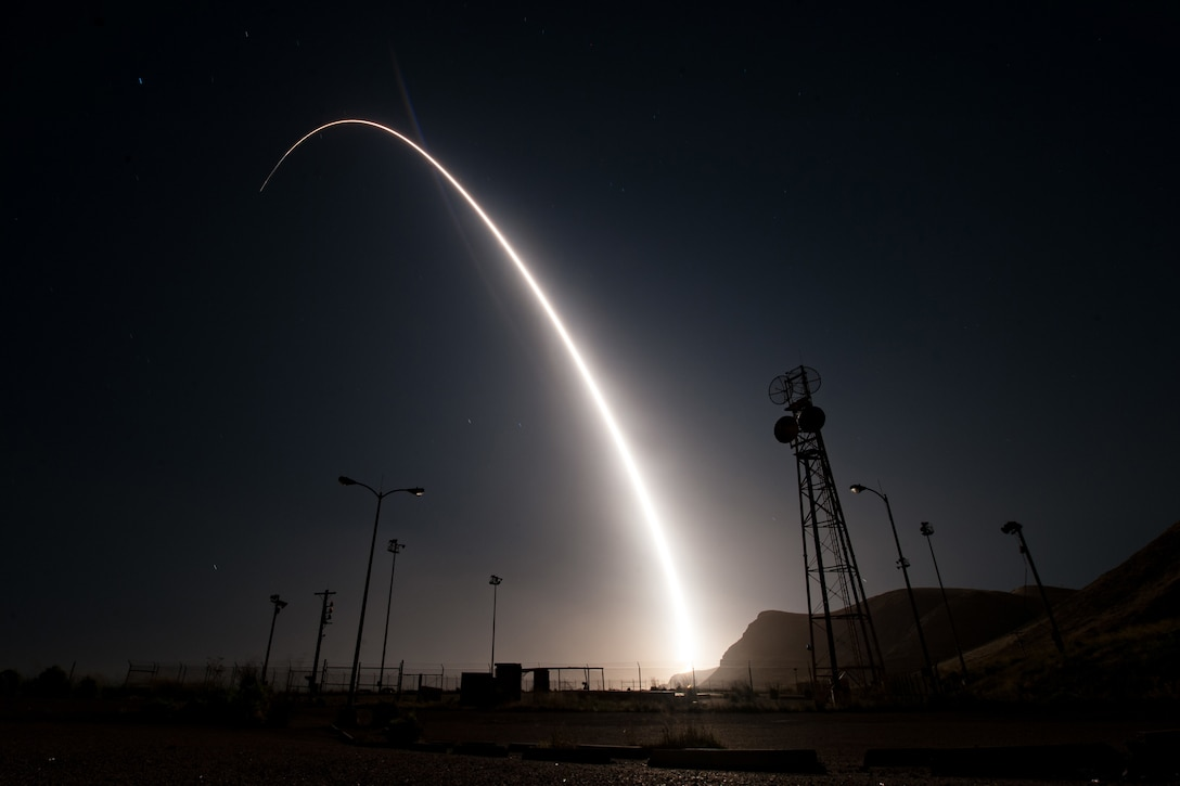 A rocket launches at night