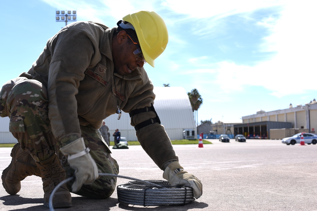 Tech. Sgt. Mitchell Brewington, 39th Maintenance Squadron crew chief, pulls a cable from a jersey barrier after an F-4 Phantom II lift March 8, 2019, at Incirlik Air Base, Turkey.