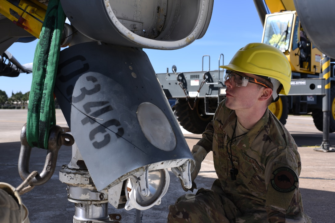 Staff Sgt. Cody Walker, 39th Maintenance Squadron crew chief, inspects a sling attached to the landing gear of an F-4 Phantom II March 8, 2019, at Incirlik Air Base, Turkey.