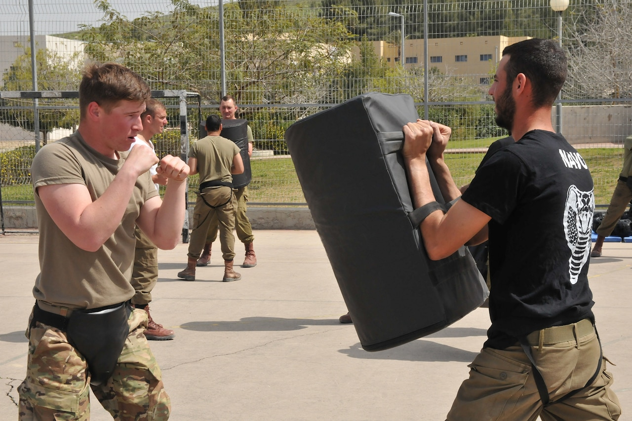 Israeli and U.S. troops practice hand-to-hand combat.