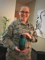 U.S. Air Force Airman 1st Class Ewa Lach assigned to the 105th Airlift Wing displays her upstander cup at Stewart Air National Guard Base, New York, March 21, 2019. (U.S. Air National Guard photo by Staff Sgt. Megan Floyd)