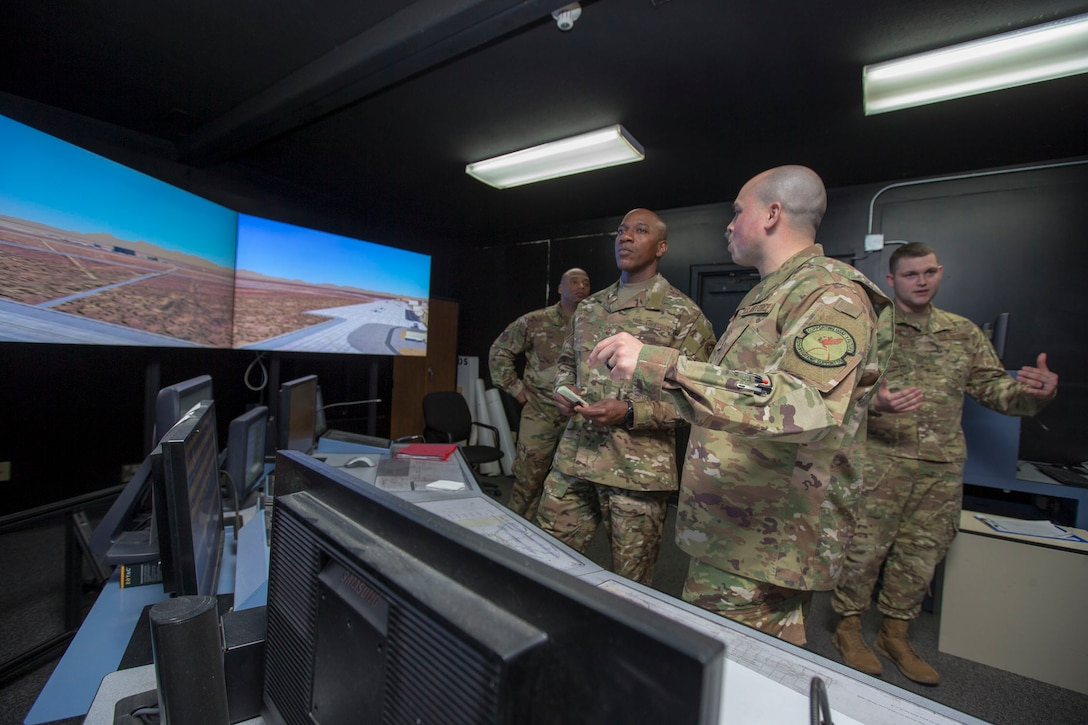 Senior Master Sgt. Joshua Matias, 412th Operations Support Squadron (right), briefs Chief Master Sgt. of the Air Force Kaleth O. Wright at the Edwards Air Force Base tower simulator used for training, March 19, 2019. Matias is a current Air Force 12 Outstanding Airmen of the Year awardee. Wright received a two-day tour of Edwards Air Force Base. (U.S. Air Force photo by Christopher Okula)