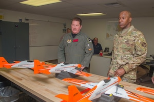 Anthony Accurso, 412th Test Wing Emerging Technologies Combined Test Force (left), discusses small unammed aircraft systems with Chief Master Sgt. of the Air Force Kaleth O. Wright, March 19, 2019. (U.S. Air Force photo by Christopher Okula)