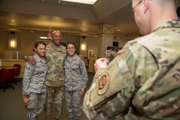 Chief Master Sgt. of the Air Force Kaleth O. Wright poses for a photo with Airman 1st Class Kyesha Thomas, 412th Security Forces Squadron (left), and Airman 1st Class Parris Gonzalez, U.S. Air Force Test Pilot School, at the Joshua Tree Inn Dining Facility, March 18, 2019. The Air Force's top enlisted Airman received a two-day tour of Edwards Air Force Base. (U.S. Air Force photo by Christopher Okula)