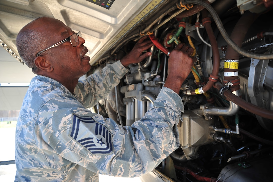 Senior Master Sgt. Charles Moore, 803rd Aircraft Maintenance Squadron production superintendent, examines a C-130J Super Hercules engine March 20, 2019. His retires from a 33 year military career in the 403rd Wing, April 1, 2019. (U.S. Air Force photo by TSgt. Michael Farrar)