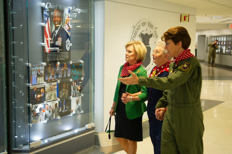 Thee women look at a display in the Pentagon.