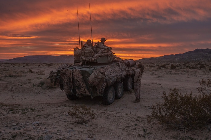 U.S. Marines with 2nd Light Armored Reconnaissance Battalion, 2nd Marine Division recuperate after conducting night time security during a deployment for training at Fort Irwin, California, March 10, 2019. The Marines of 2d Light Armored Reconnaissance Battalion participated in National Training Center 19-05 as the opposing force against the 2nd Armored Brigade Combat Team, 1st Infantry Division. The exercise provided Marines and Sailors an opportunity to sustain training in primary conventional combat operations against a peer competitor.