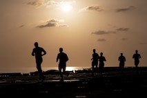 U.S. Marines with the 22nd Marine Expeditionary Unit run on the flight deck during a physical fitness test aboard the Wasp-class amphibious assault ship USS Kearsarge. Marines performed the test before starting a Martial Arts Instructor Course to ensure they could meet the physical demands of the training. Marines and Sailors with the 22nd MEU and Kearsarge Amphibious Ready Group are currently deployed to the U.S. 5th Fleet area of operations in support of naval operations to ensure maritime stability and security in the Central region, connecting the Mediterranean and the Pacific through the western Indian Ocean and three strategic choke points.