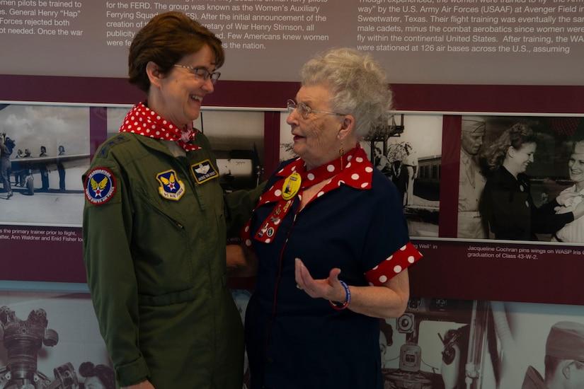 Two women laugh