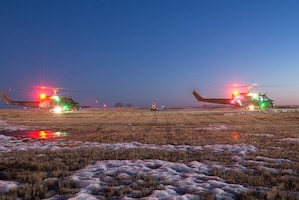 Night Flight: Hueys take off at Minot AFB