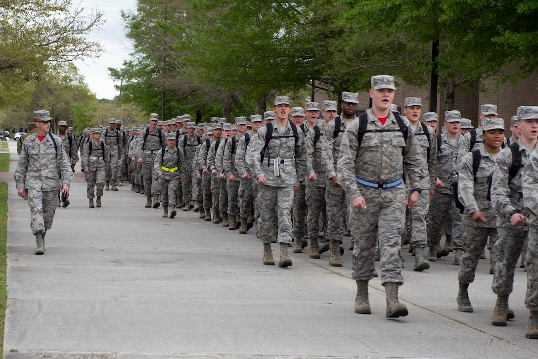 U.S. Air Force Tech. Sgt. Joshua Free, 336th Training Squadron military training leader, marches the 336th TRS students to their dorms at Keesler Air Force Base, Mississippi, March 15, 2019. While marching, Free ensures the Airmen maintain their military bearing in order to continue the disciplinary foundation provided in Basic Military Training. (U.S. Air Force photo by Airman 1st Class Kimberly L. Mueller)