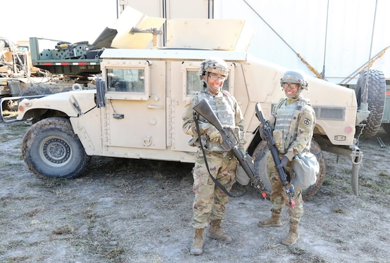 Two female Soldiers teaming up at JRTC