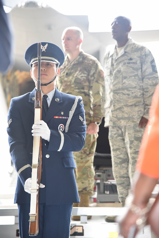 A member of the Keesler Air Force Base, Mississippi, Honor Guard stands at attention during the National Anthem as part of a retirement ceremony honoring Senior Master Sgt. Charles Moore March 8, 2019.  Moore retires from his duties as a production superintendent with the 803rd Aircraft  Maintenance Squadron April 1, 2019. He served 33-years in the Air Force Reserve. (U.S. Air Force photo by Tech. Sgt. Michael Farrar)