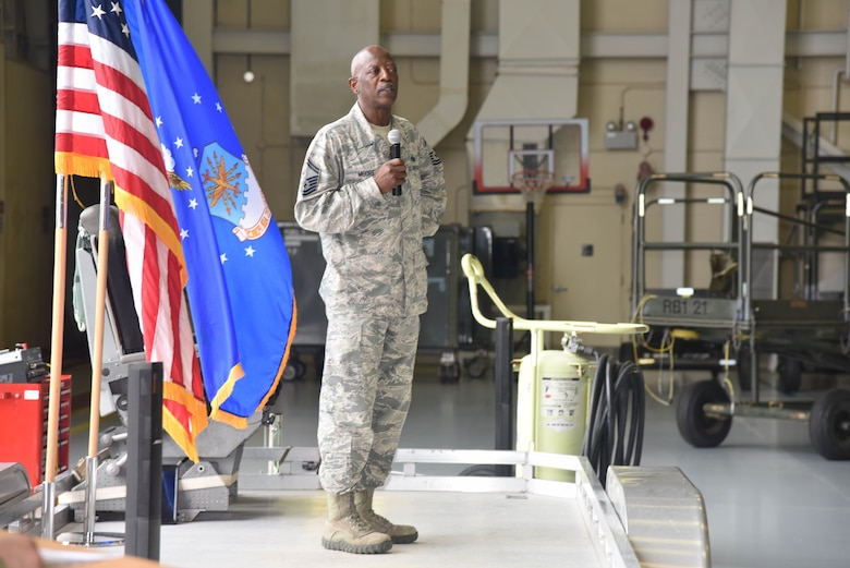 Senior Master Sgt. Charles Moore, 803rd Aircraft Maintenance Squadron production superintendent, addresses gathering during his retirement ceremony, March 8, 2019.  Moore offiicially retires from a 33 year military career, April 1, 2019. (U.S. Air Force photo by TSgt. Michael Farrar)