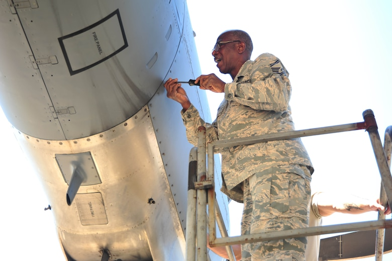 Senior Master Sgt. Charles Moore, 803rd Aircraft Maintenance Squadron production superintendent, unscrews C-130 Super Hercules engine cover on the Keesler Air Force Base, Mississippi, flight line. March 21, 2019.  Moore retires from a 33 year military career in the Air Force Reserve, April 1, 2019.(U.S. Air Force photo by Tech. Sgt. Michael Farrar)