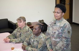 From left to right – Maj. Everetta Davis, knowledge management officer, Sgt. Major Gail Lashley, senior enlisted advisor, logistics, G-4, and Sgt. Maj. Tonya Cason, senior enlisted advisor, Support Operations (SPO), 1st Theater Sustainment Command (TSC), listen to Soldiers talk March 15 at the first meeting of the 1st TSC's Sisters in Arms program. (U.S. Army photo by Master Sgt. Jonathan Wiley)