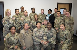 Attendees of the 1st Theater Sustainment Command's (TSC) Sisters in Arms meeting pose for a group shot March 15. (U.S. Army photo by Master Sgt. Jonathan Wiley)