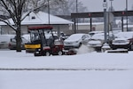 Defense Distribution Center Susquehanna Roads and Grounds team member Steve Brewbaker clears snow from the sidewalks around the Eastern Distribution Center.